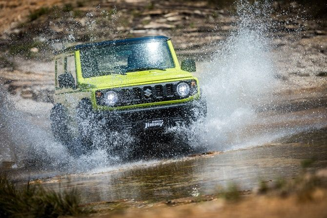 Five Reasons Why People Want The New Suzuki Jimny Right Now Front Splashing Through Water