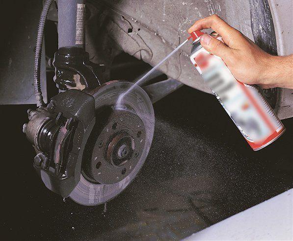 Spraying brake cleaner