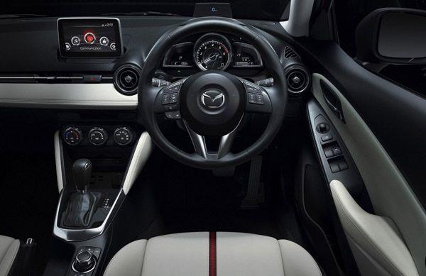 https://img.icarcdn.com/autospinn/body/2014-Mazda2-50-850x551.jpg