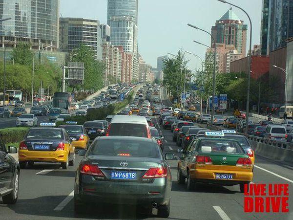 https://img.icarcdn.com/autospinn/body/2014-beijing-taxi-2.jpg