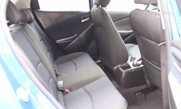 https://img.icarcdn.com/autospinn/body/2015-mazda-2-interior-revealed-in-a-video-2.jpg