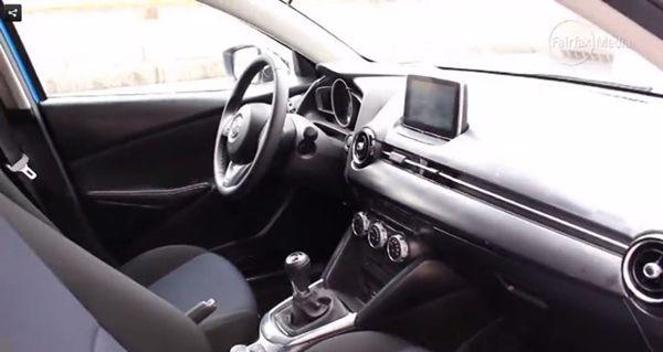 https://img.icarcdn.com/autospinn/body/2015-mazda-2-interior-revealed-in-a-video-3.jpg