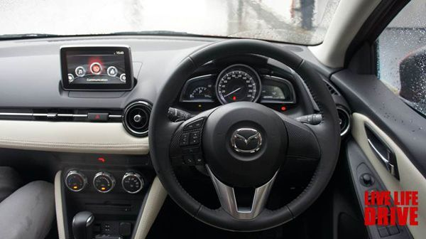 https://img.icarcdn.com/autospinn/body/2015-mazda-2-test-drive-in-japan-10.jpg