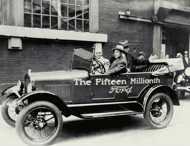 Edsel Ford drives his father, Henry, out of the Ford Highland Park Plant in the very last Model T ever made
