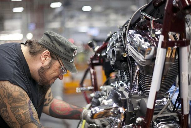 Chris Beck works on the assembly line in Harley-Davidson's York, Pa. factory that builds Touring, Softail and Trike motorcycles. The new manufacturing system can quickly be reconfigured to handle increased demand for certain models as all of the bikes are now built on the same line. --- CREDIT: Harley-Davidson Inc.